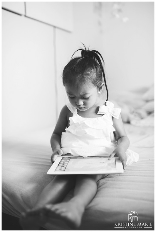 Little girl on ipad photo san diego newborn baby photographer kristine marie photography