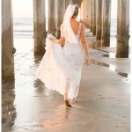 Bride walking under the pier | Scripps Seaside Forum Wedding | La Jolla San Diego Wedding Photographer | Kristine Marie Photography | © www.kristinemariephotography.com
