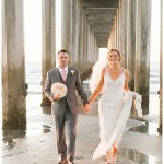 Bride and groom under the pier | Scripps Seaside Forum Wedding | La Jolla San Diego Wedding Photographer | Kristine Marie Photography | © www.kristinemariephotography.com