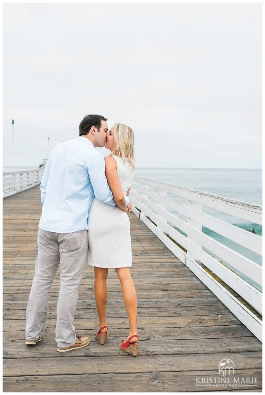 Engaged Kissing On Crystal Pier Pacific Beach San Go Engagement Photographer Kristine Marie Photography