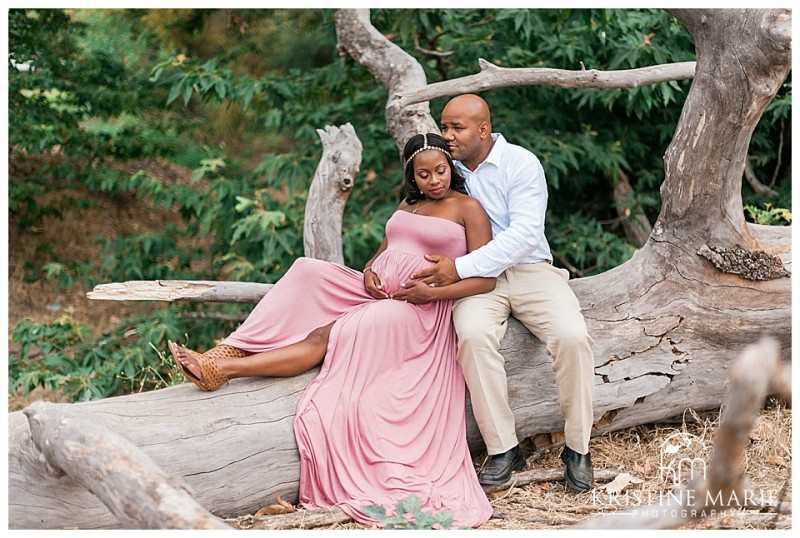Photography Husband And Pregnant Wife On Large Tree Trunk